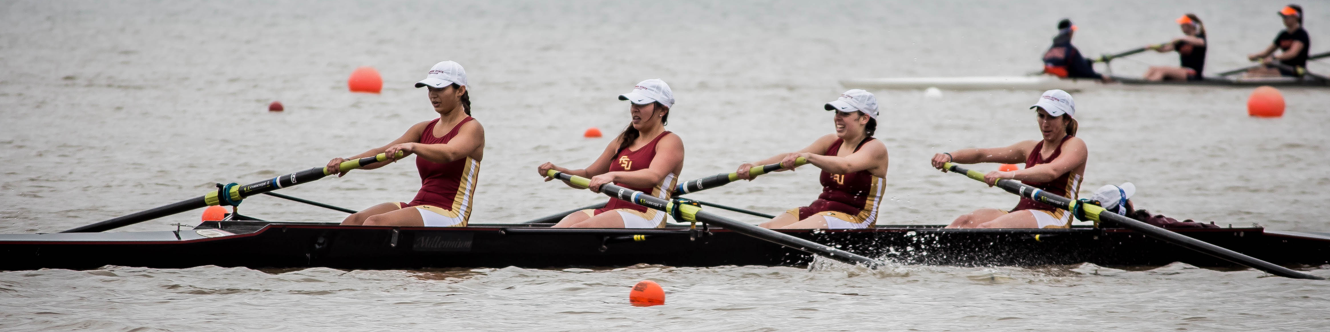 4 girls rowing