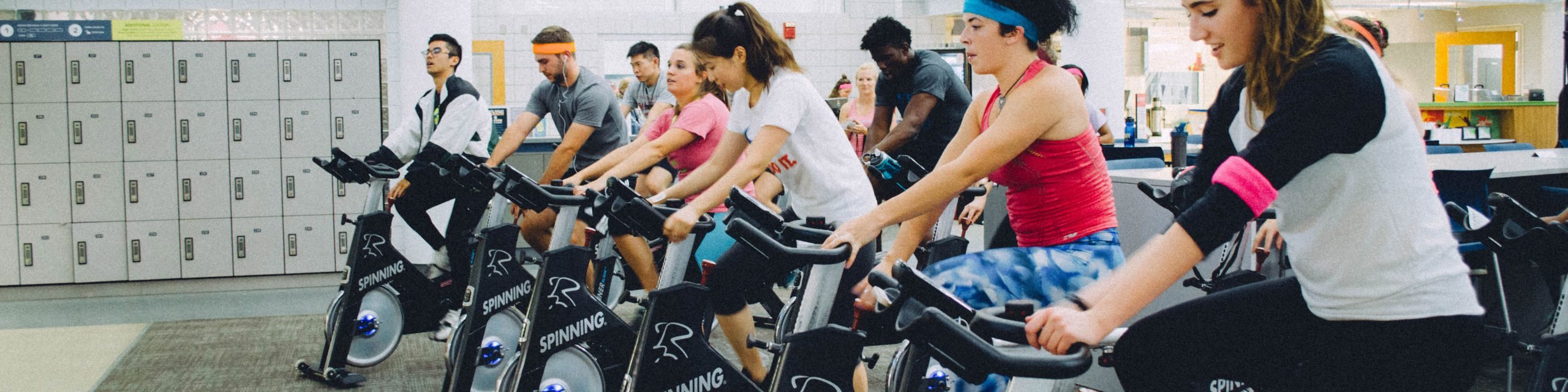 People participating in a spin class.