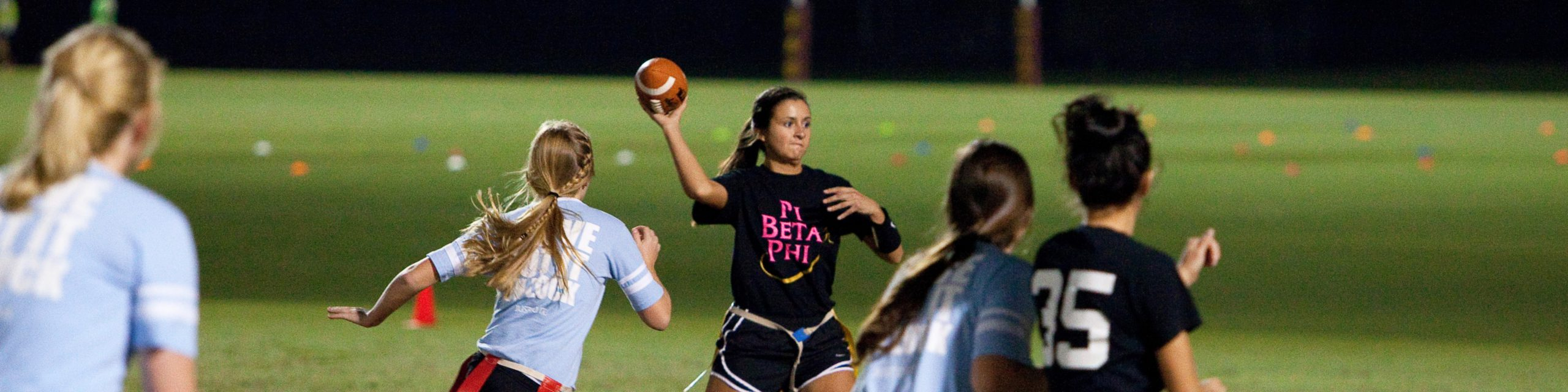 Girl playing flag football