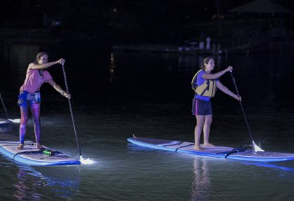 3 people paddle boarding.
