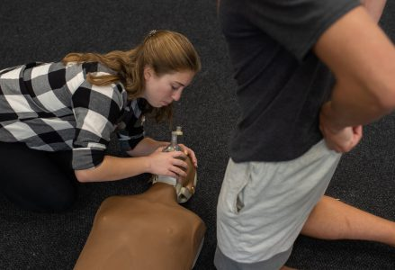 A girl giving CPR